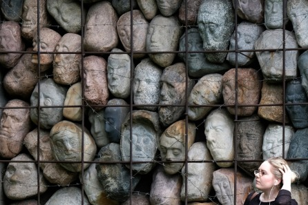 wall-of-faces-statues-cage.jpg