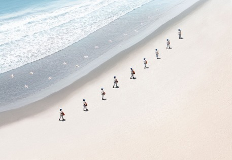 walking-on-beach-many-men-series