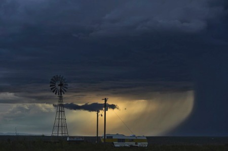 wife-lament-farm-windmill-sky-storm